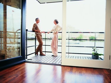 Mature Couple Talking on the Balcony of Their Apartment