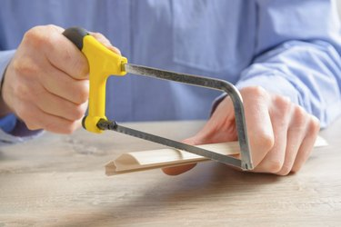 Cutting plastic molding with handsaw