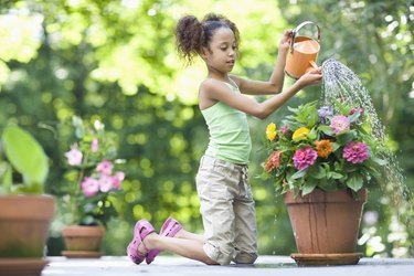 Girl Watering Potted Flowers