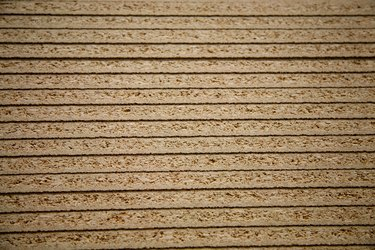 Close-up of stack of particleboard