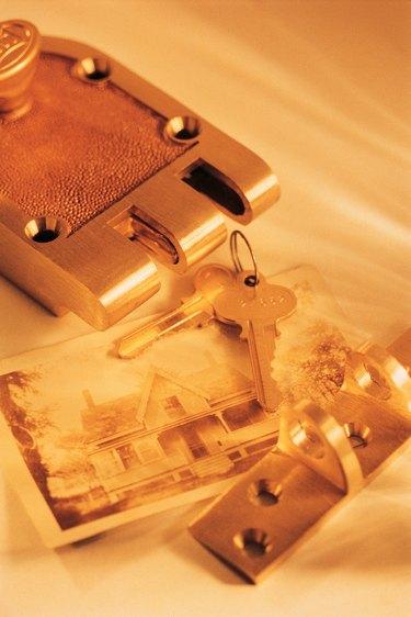 Door lock , keys and photo of house