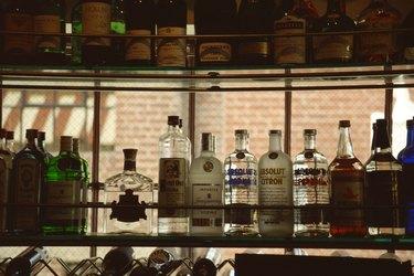 Liquor bottles in bar window