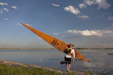 paddler with wooden sea kayak