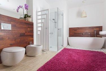 Red carpet in bright bathroom