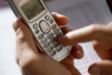 Person operating a mobile phone