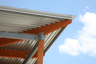 Detail of corner of metal roof and wooden support beams