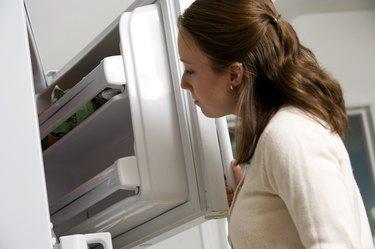 Woman looking in freezer