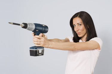 Woman with power drill
