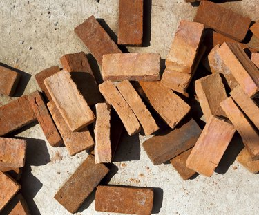 Brick stack on the ground for building.