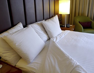 turned down white bed linen