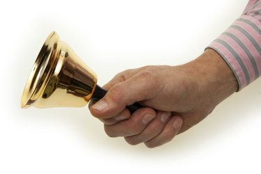Hand  with brass bell