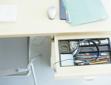 Headset in open desk drawer,high angle view