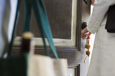 Woman unlocking door