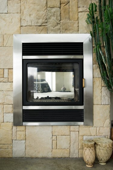 Contemporary fireplace between rooms