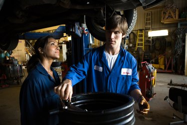 Mechanics doing oil change