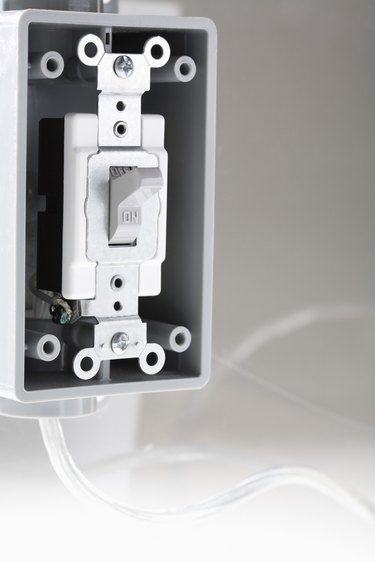 Light switch with missing face plate