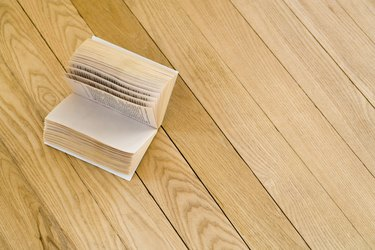 Open book on hardwood floor
