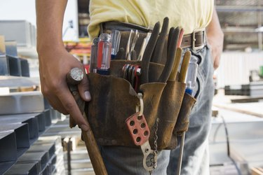 Tool belt on construction worker