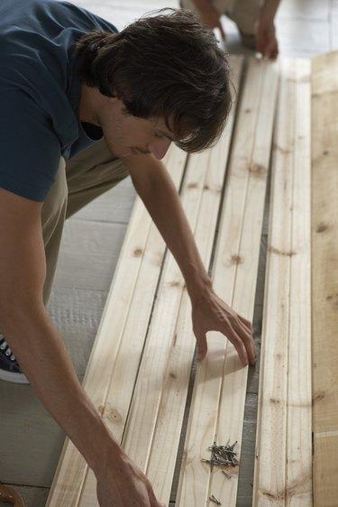 Man selecting lumber