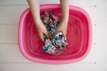 Hands washing laundry