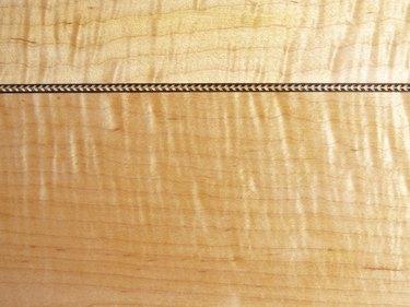Tiger Maple and Herringbone Background