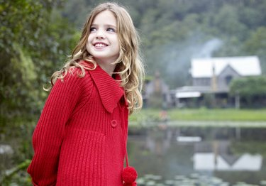 Girl outdoors in front of country home