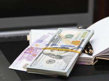 Paper money, notebook, handle.