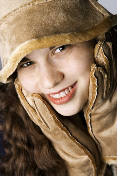 Teenage girl in hat and gloves