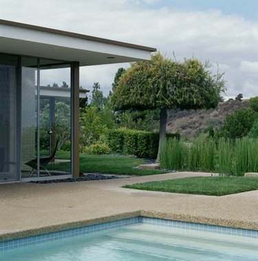 Swimming pool and landscaped yard alongside modern home