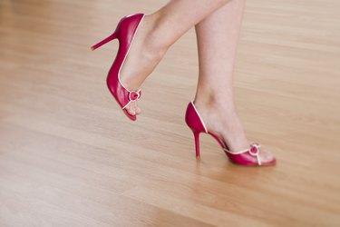 Woman standing in high heels