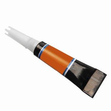 Close up of a tube of super glue