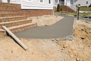Wet cement walkway at construction site