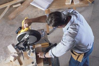 Construction worker using circular saw