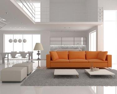 The white room,  orange sofa