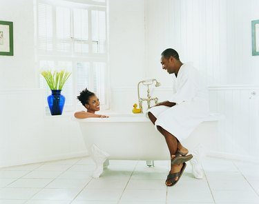 Couple Sitting in a Bathroom