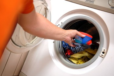 Taking out clean washing load