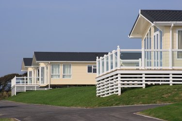 Three static holiday homes or caravans