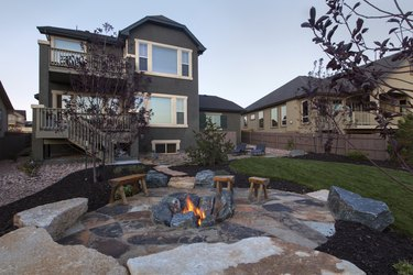 Landscaped backyard with beautiful Fire pit