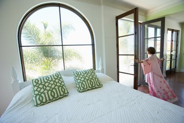 Woman in home looking out at beach