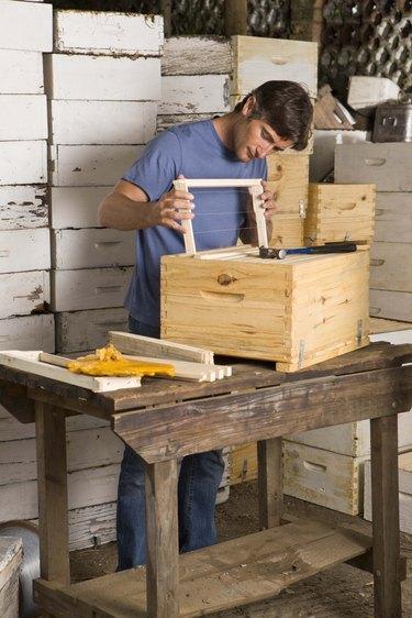 Man building beehives