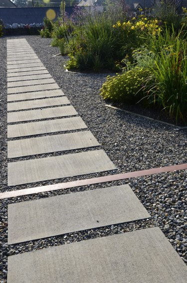 world landscape architecture multiple hardscape materials stone tile walkway surrounded by gravel