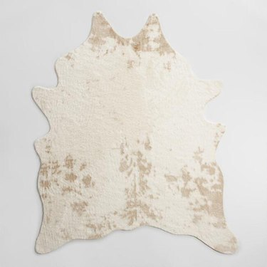 Cream and beige faux cowhide area rug
