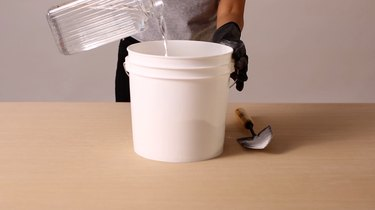 Adding water to Portland cement and sand mixture
