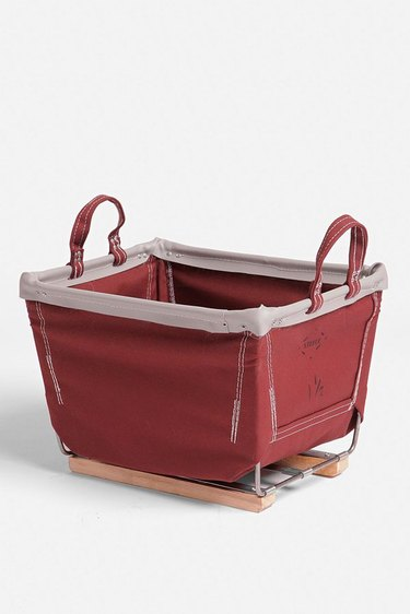 A red canvas storage bin on wooden sleds.