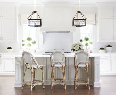 farmhouse kitchen with pendant lights hanging above island