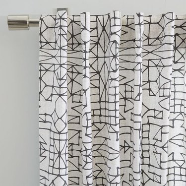White curtain featuring black sketchy lines all over