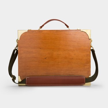 A briefcase-like wooden desk with a carry case.