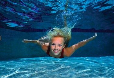 Girl swimming underwater.