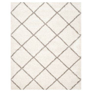 Cream rug with subtle brown criss-cross lines