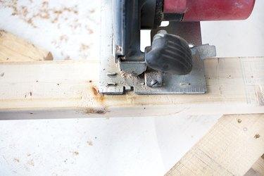 Circular saw cutting 2x4.